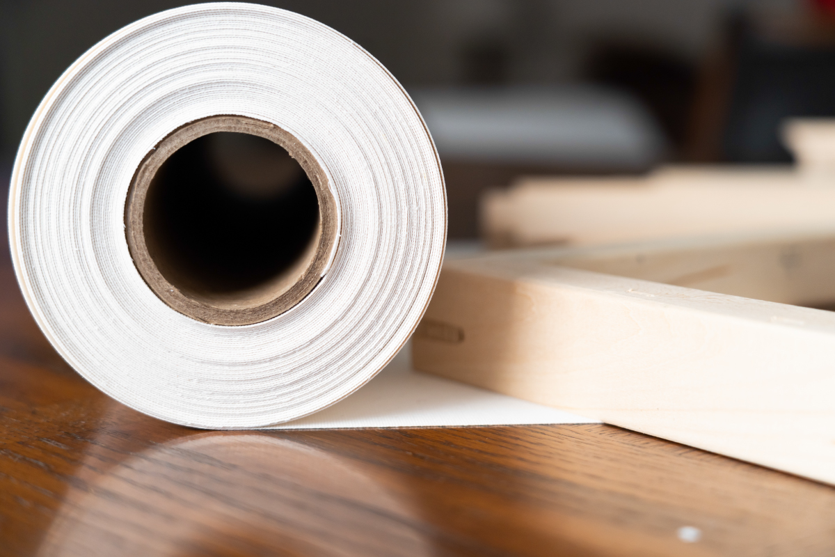 Roll of canvas on table