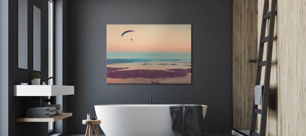 Should you display canvas in bathroom? Canvas print with sunset displayed in modern bathroom.