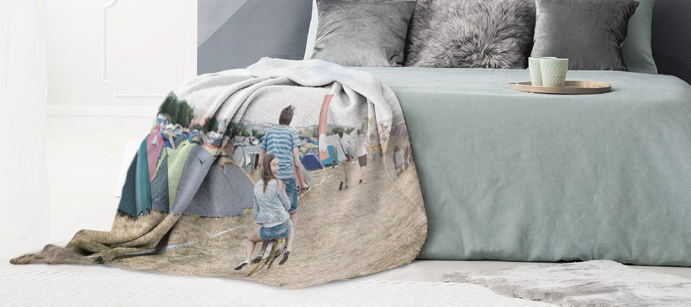 Where to create a blanket with your own picture on it. Photo blanket with couple in festival.