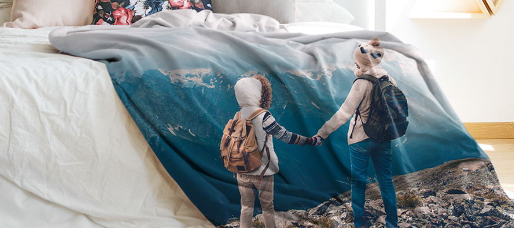 Where to create a blanket with your own picture on it. Photo blankets with two kids and mountains.