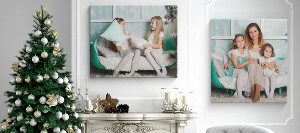 Christmas canvas prints. Christmas canvas prints on wall with Christmas tree next to them.