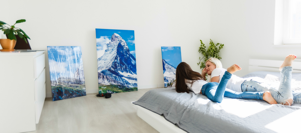 Why are Canvas Prints so Expensive? Mother and daughter looking at photo canvas prints.