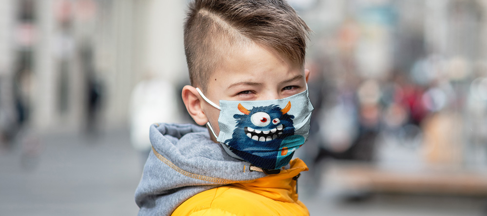 Where to Buy Custom Face Masks Online. Little kid wearing personalized face mask.