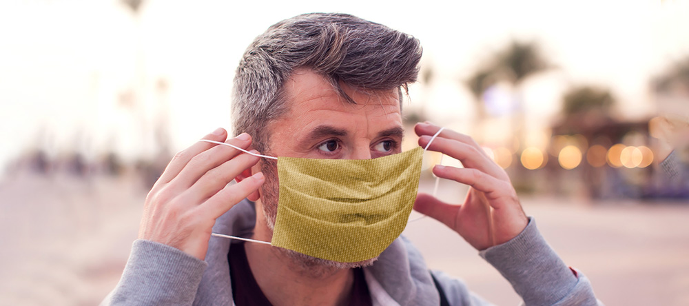 Where to Buy Custom Face Masks Online. Adult man wearing personalized face mask.