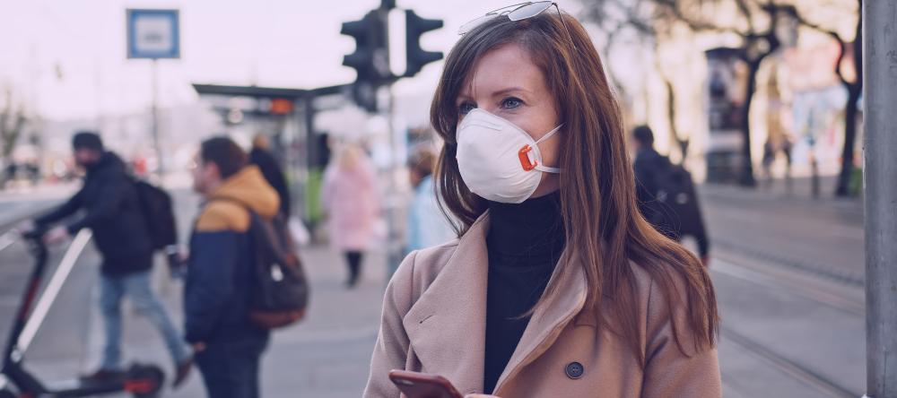 Where to Buy Custom Face Masks Online. Woman wearing N95 respirator.
