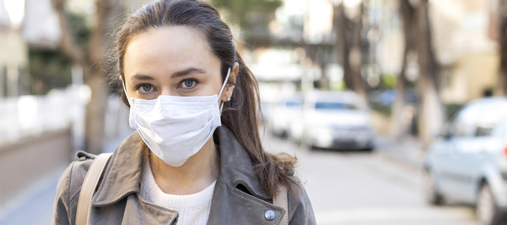 Where to Buy Custom Face Masks Online. Young woman wearing surgical face mask.