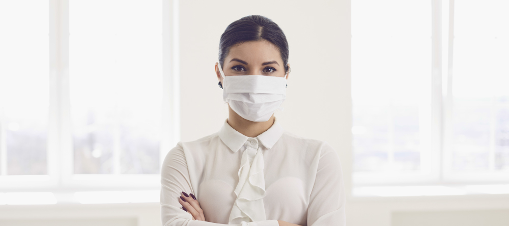 Where to Buy Custom Face Masks Online. Young business woman wearing surgical mask.