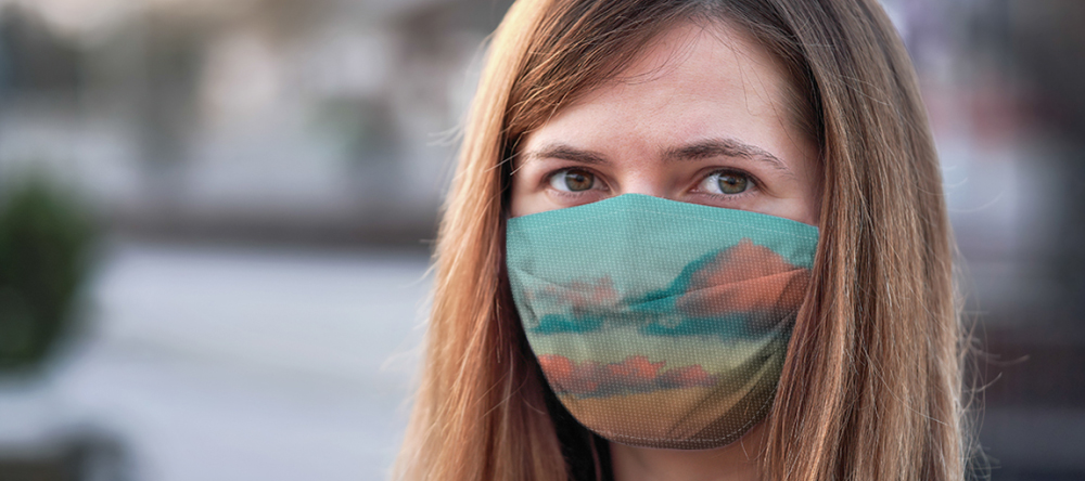 When you should wear a face mask. Young woman wearing colorful face mask.