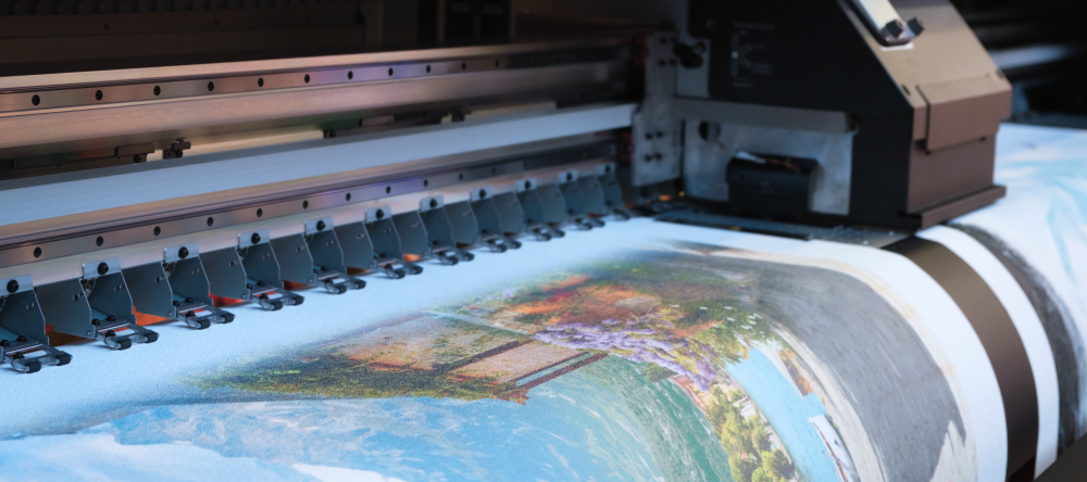 What is canvas made of. Image of industrial printer printing on canvas.