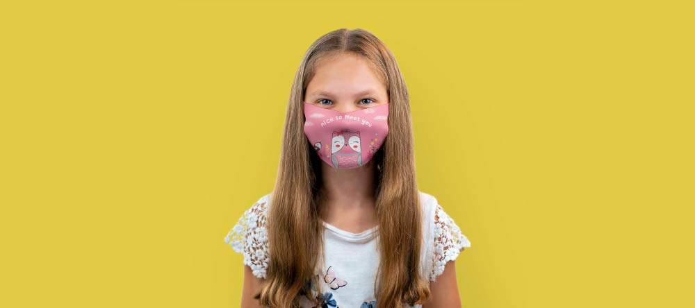 How to make a custom face mask. Little schoolgirl posing with personalized mask.