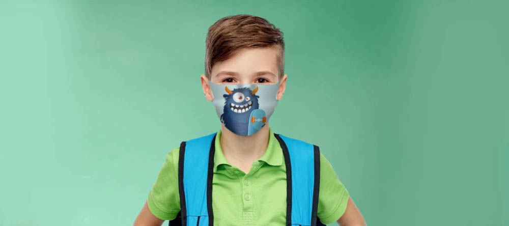 How to make a custom face mask. School boy posing with personalized face mask.