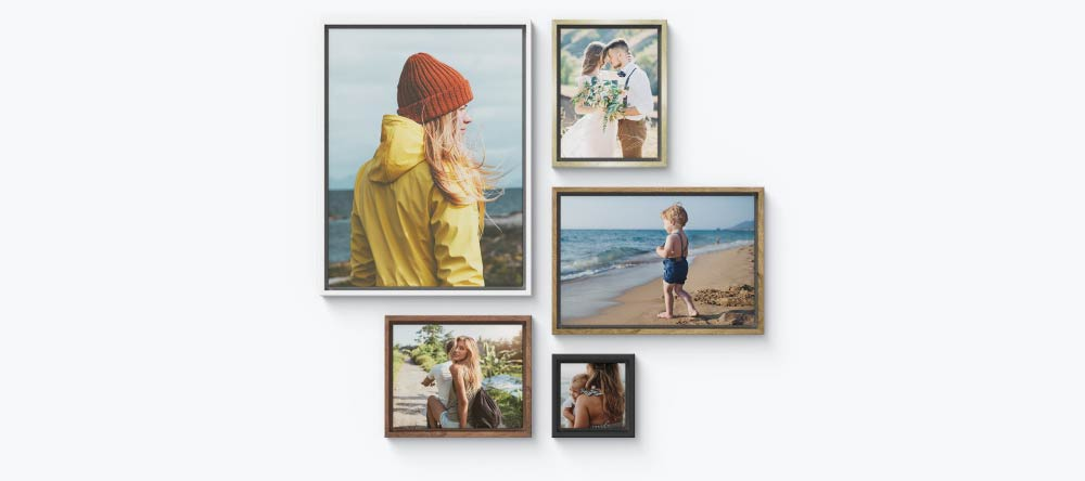 How to Frame Canvas Prints. Gallery wall with multiple framed canvas prints.