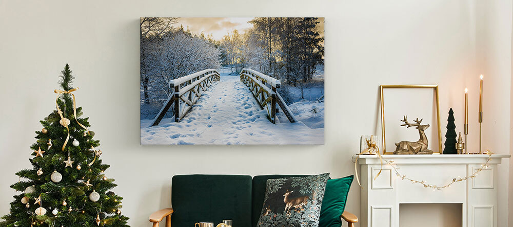 Your Essential Guide to Christmas Canvas Ideas. Beautiful Christmas decor and photo canvas print with a winter landscape.