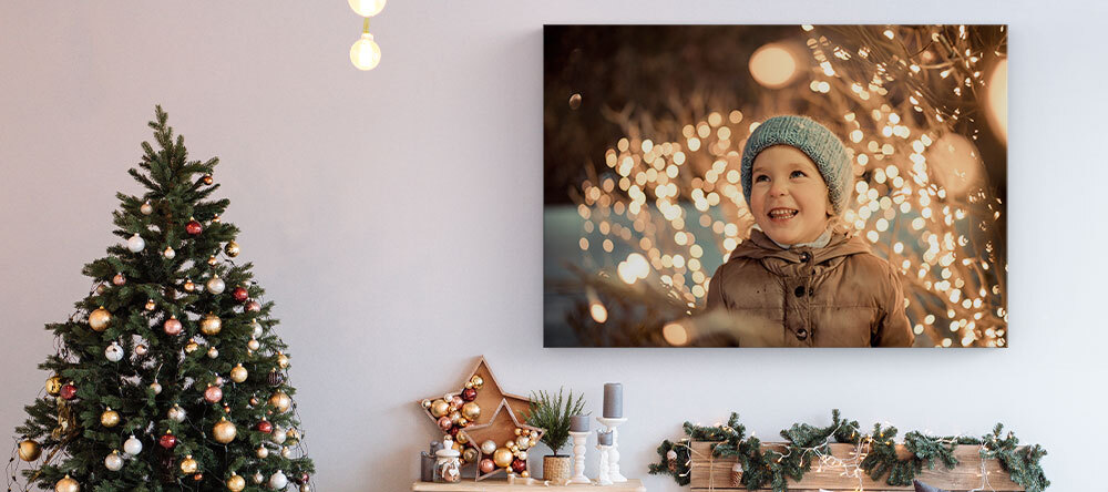 Your Essential Guide to Christmas Canvas Ideas. Photo canvas print of smiling child.
