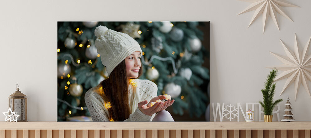 Your Essential Guide to Christmas Canvas Ideas. Photo canvas print with woman and strings lights.
