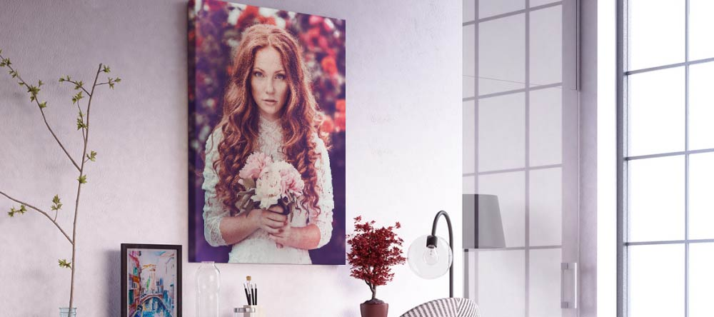 The Pros & Cons of Canvas Printing. Photo canvas print showing young lady with flowers.