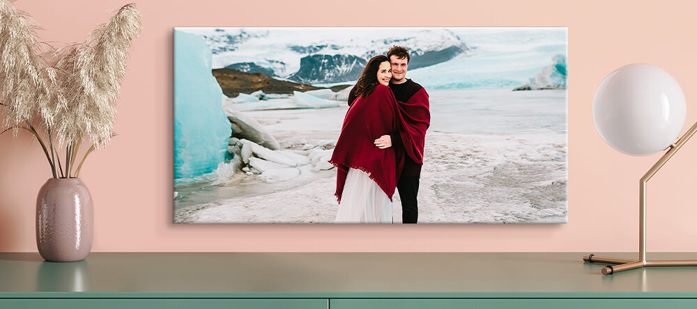 Romantic Canvas Prints: How to Choose the Best Photos. Romantic photo canvas print featuring couple under blanket.