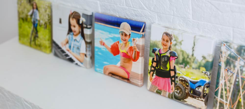 Custom-Made Canvases: 10 Myths Debunked. Multiple small-size canvas prints on mantel.