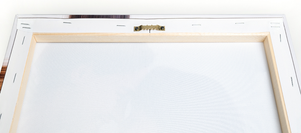 How to hang your canvas print. The complete guide. Sawtooth hanger on stretcher bar.