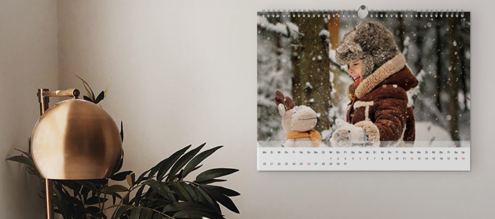 Photo gifts for her. Personalised photo calendar on wall.