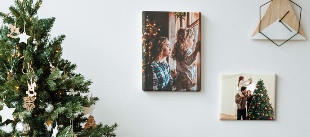 Unique Christmas Gifts for Him. Two photo canvas prints next to Christmas tree.