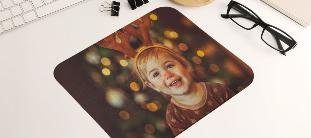 Unusual stocking fillers. Personalised photo mouse pad with photo of kid.