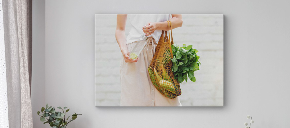 What is Lamination on Canvas Prints. Print on wall showing woman holding vegetables.