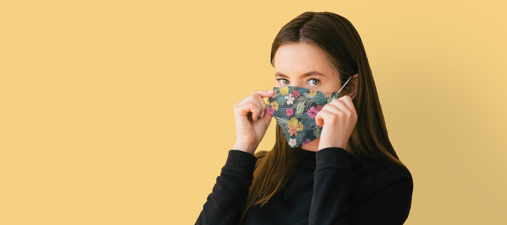 Personalised face masks. Young woman wearing custom face mask.