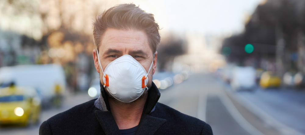 Personalised face masks. Man wearing respirator face mask in public.
