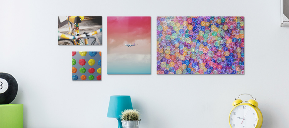 What is an aluminium print. Multiple colorful aluminium prints displayed on wall.