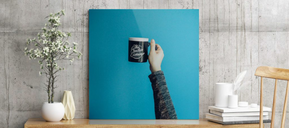 Build Your Business with Acrylic Prints. Beautiful acrylic photo print with hand holding mug.
