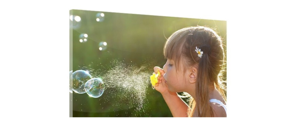 How to Hang Acrylic Prints.Photo acrylic print featuring girl blowing soap bubbles.