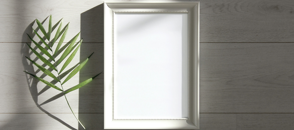 How to Hang Acrylic Prints. A beautiful white empty frame.