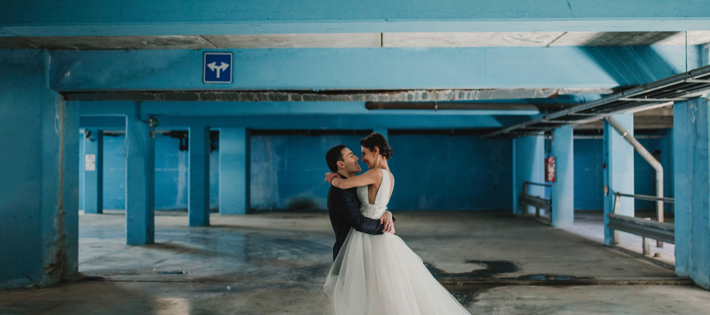 New photo trends for 2021. Newlyweds in a parking lot.
