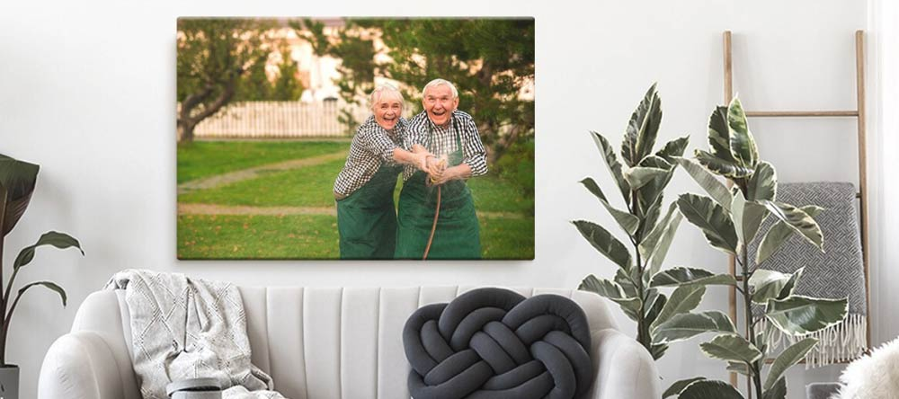 Romantic Canvas Wall Art – How to Do It Right. Photo canvas print of adorable elderly couple.