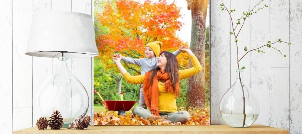 How to Clean a Canvas Print. Beautiful photo canvas print with mother and child in autumnal setting..