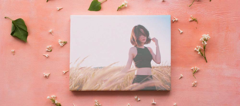 What is a Canvas Print? Small-format canvas print with photo of young lady.
