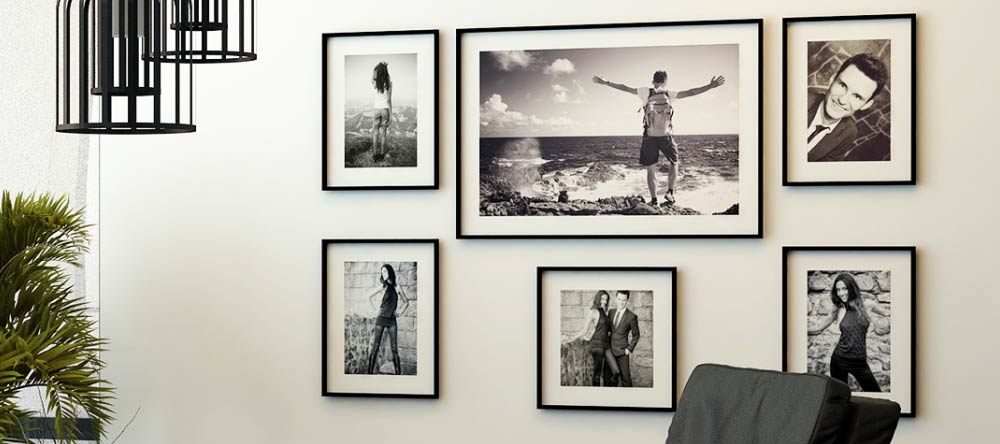 Where to Get Framed Wall Pictures for Living Room: High-Quality Prints in Minutes. Gallery wall featuring framed prints of monochromatic photos.