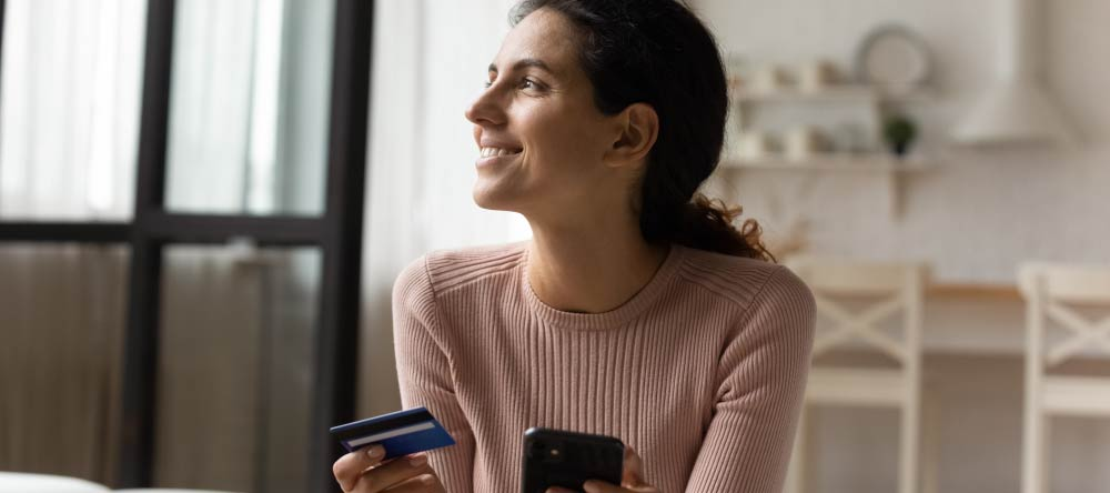 How to Print Pictures from Phone Storage. Happy lady placing her order using her phone.