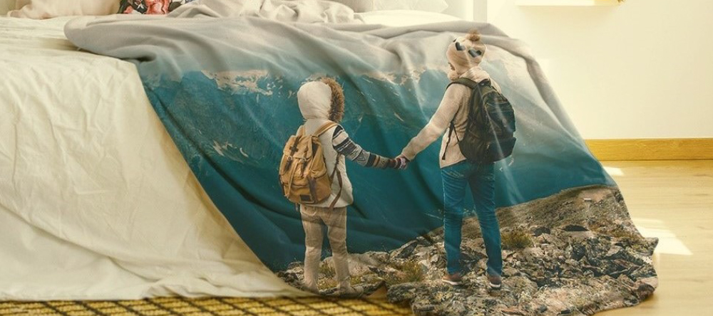 Latest lifestyle trend. Personalised photo blanket with two kids and a mountain terrain.