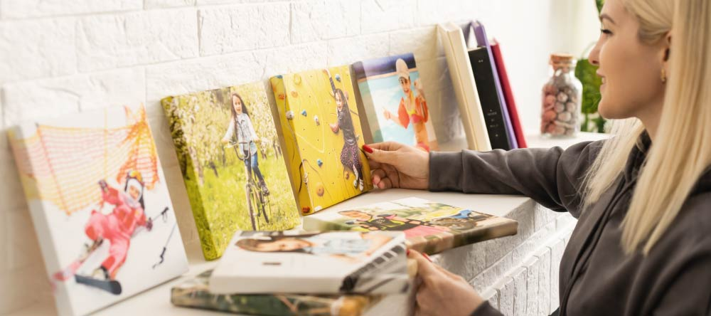 Where to Print Pictures Near Me. Young woman being happy about her canvas prints.