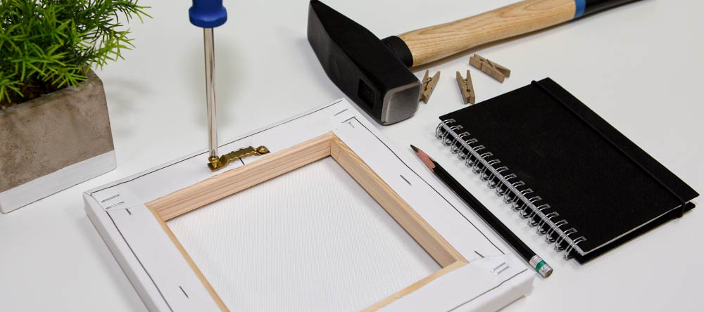 Hanging Kit for Canvas – Do You Need It? Using screwdriver to attach sawtooth hanger to canvas print.