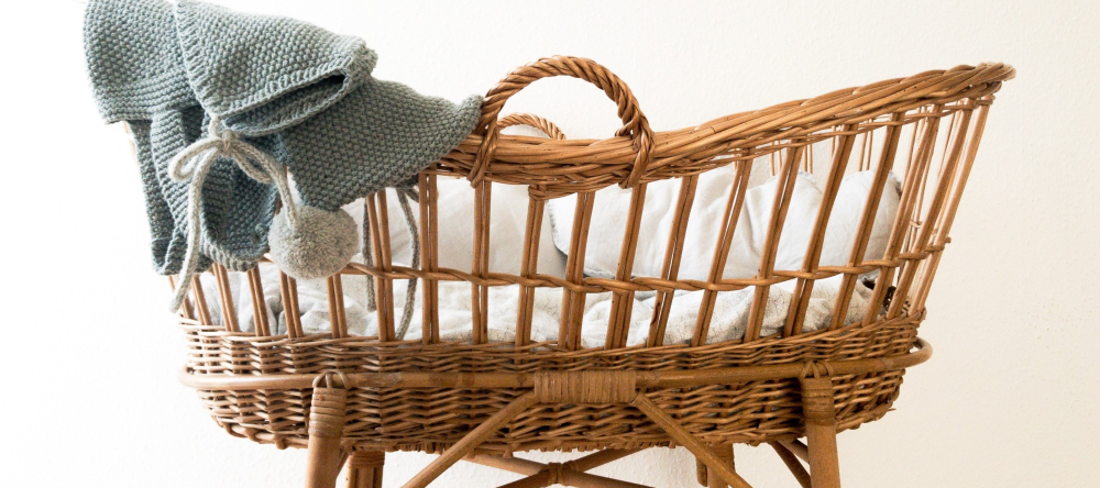 What do you take to a baby shower. A child's cot with a knitted garment.