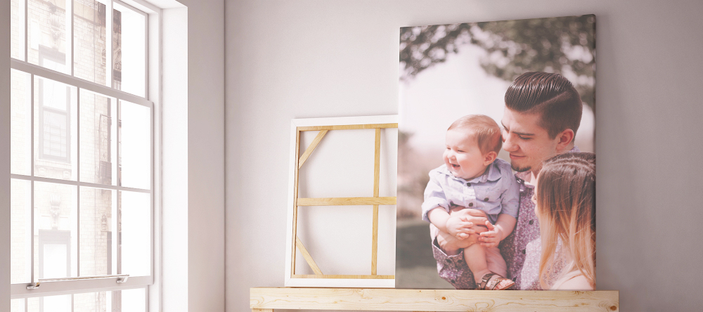 What do you take to a baby shower. Printed photo of family next to window.