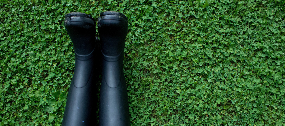 Festival Checklist. Pair of wellies lying on grass.