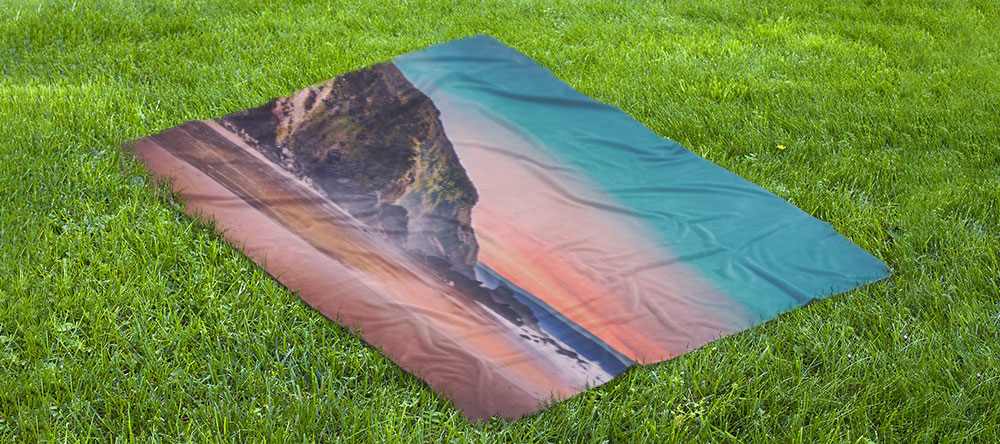 Festival checklist. Personalised photo blanket lying in grass.