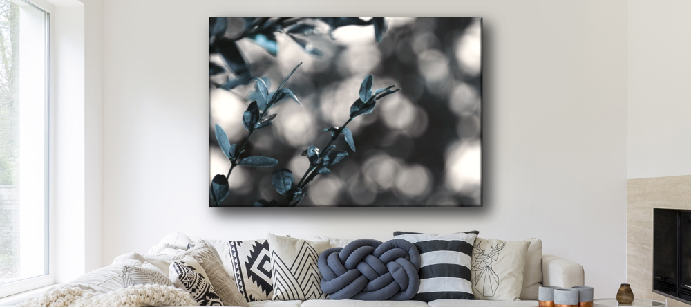 How Long Do Canvas Prints Last? Picture of branches on living room wall.