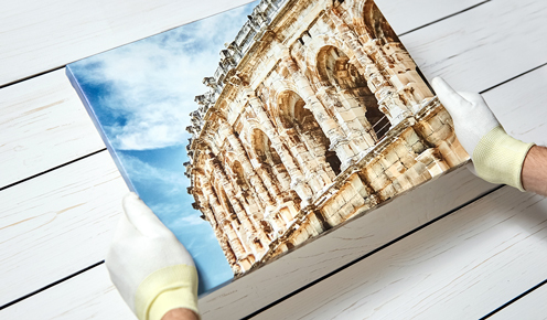 Holding Canvas Print with Gloves