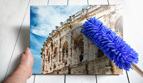 Cleaning canvas with a feather duster