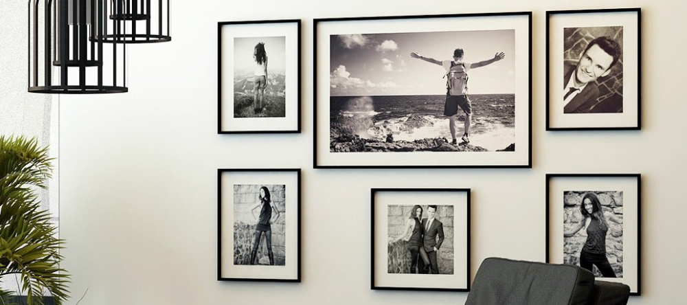 Gallery style picture walls. Beautiful black & white framed photo prints in living room.